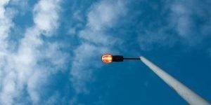 A picture of an outdoor light installation on a pole.