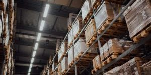 Shop Lights installed on the ceiling of warehouse with boxes on a shelf